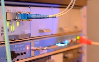 Fiber Optics with SC/APC connectors. Internet Service Provider equipment. Focus on fiber optic cables. Data Network Hardware Concept.