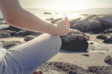 meditating woman at beach