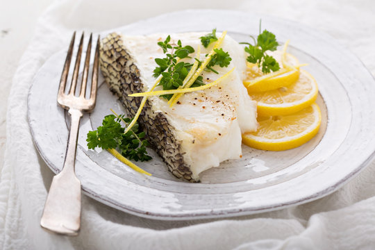 Grilled stripped bass with lemon and herbs
