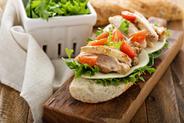 Grilled chicken sandwich with basil and tomatoes