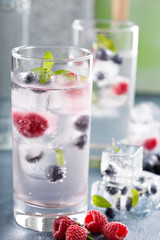 Sparkling water with berry and herb ice