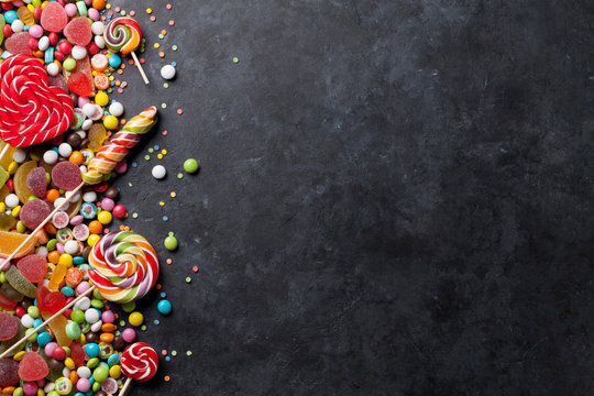 Colorful candies, jelly and marmalade over stone