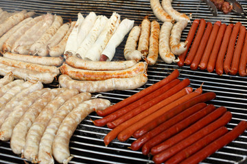 Street fast food, grilled sausages at bbq