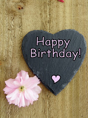 Black slate heart with pink flower and 'Happy Birthday' text