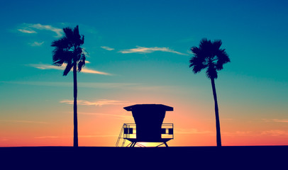 Poster Beach Vintage Lifeguard Tower - Vintage Lifeguard Tower on Beach at sunset in San Diego, California