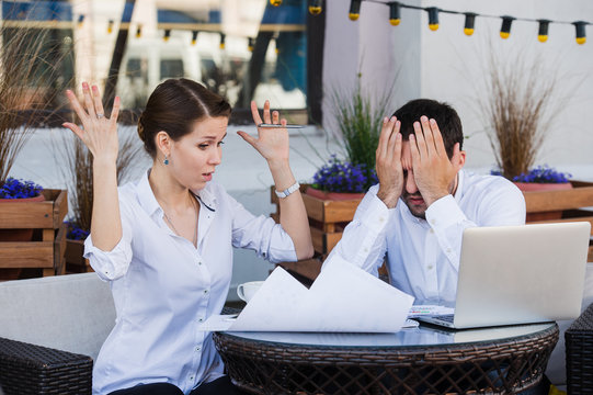 business people conflict working problem, angry boss argue scream to colleague businessmen and women serious argument negative emotion discussing report meeting at outdoors cafe during the lunch break