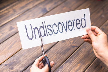 undiscovered to discovered on white paper