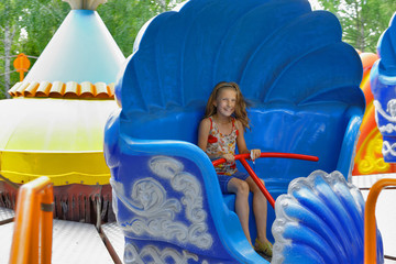 Girl riding on a spinning ride