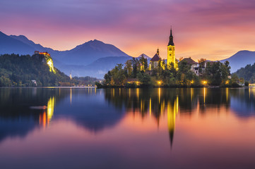 Wall Mural - beautiful, multicolored sunrise over an alpine lake Bled in Slovenia