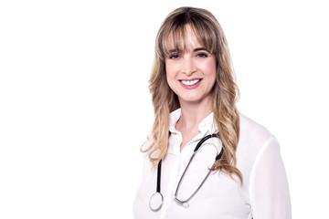 Female doctor posing to camera.