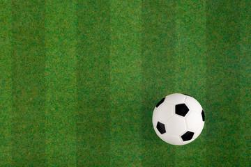 Soccer football field grass ball background. Flat lay. Top view