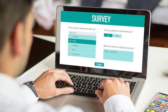Businessman filling a online customer service satisfaction surve