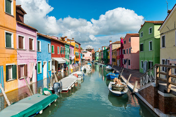 Boats moored in a colorful canal, Burano, Venice