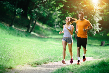 Foto op Plexiglas Jogging Healthy couple jogging in nature