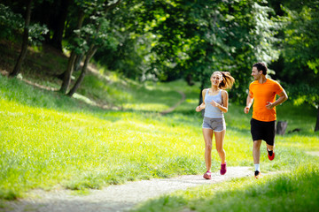 Self adhesive Wall Murals Jogging Athletic couple jogging in nature