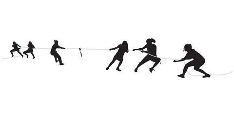 Young females pulling a rope in tug of war