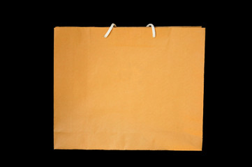 Brown paper bag with isolated, black background.
