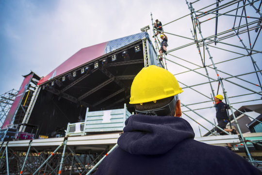building entertainment stage for music festival wearing safety c