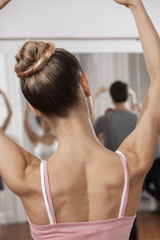 Ballet Dancer With Arms Raised In Dance Studio