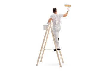 Male decorator painting with a roller