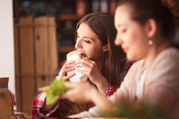 Portrait of vegeratian ladies in cafe