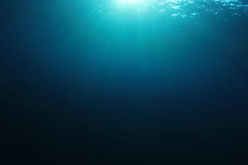 Underwater ocean background in sea with sunlight
