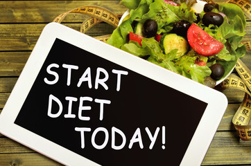 The words Start diet today on tablet