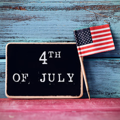 text 4th of July and American flag