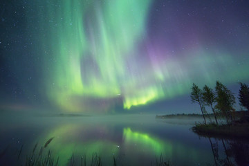 Aurora borealis over lake, Finland