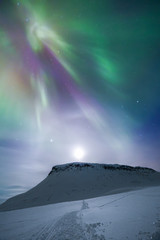 Aurora borealis over mountain, Finland