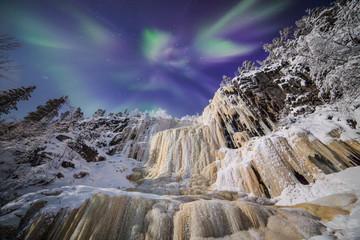 Aurora borealis and rocky outcrop, Finland