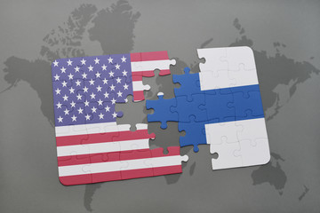 puzzle with the national flag of united states of america and finland on a world map background