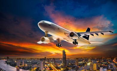 Airplane over night scene city Wall mural