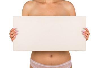 junge sexy Frau mit nackter Brust und Hinweisschild bzw. Pfeil an/vor Brust