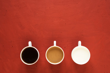 Three cups with milk and coffee