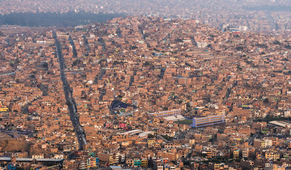 Panoramic aerial view of a poor town in Chorrillos, Lima.