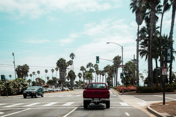 Car in crossing near the beach with palm trees, California, Unit