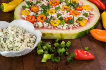 Vegetarian watermelon pizza with crumbled blue cheese, bell peppers and parsley.