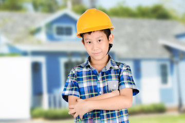 Young Asian Architect with house background