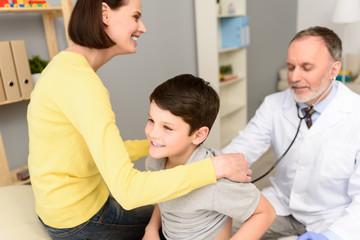 Pediatrician doctor examining child