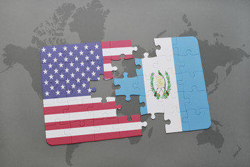 puzzle with the national flag of united states of america and guatemala on a world map background