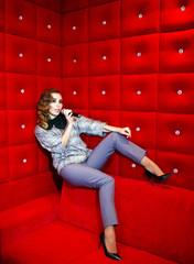 beautiful girl singing karaoke in a nightclub