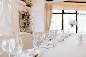 Elegant table arrangement and catering at wedding reception. Wedding decoration in restaurant