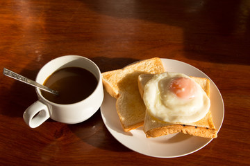 Coffee bread and eggs breakfast,traditional breakfast