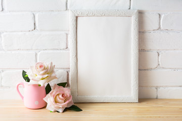 White frame mockup with two pale pink roses
