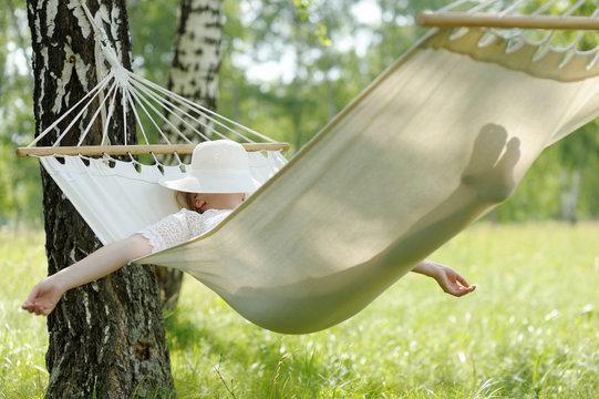 Woman resting in hammock.