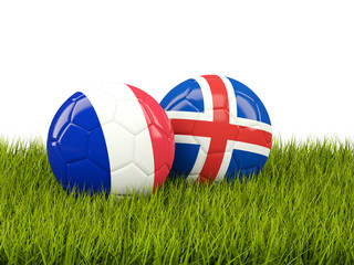 France and Iceland soccer  balls on grass