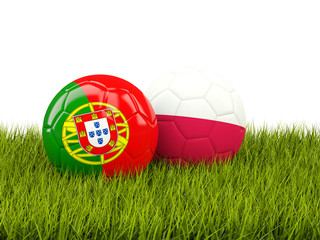 Portugal and Poland soccer  balls on grass