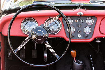 Steering wheel and dashboard in historic vintage car