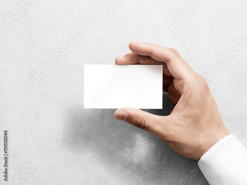 hand holding blank plain white business card design mockup clear